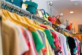 image of boutique  - Variety of clothes hanging on rack in boutique