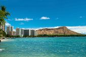 stock photo of waikiki  - Waikiki beach with azure water in Hawaii with Diamond Head in background.