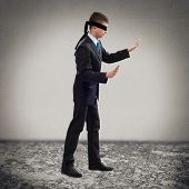 stock photo of blindfolded man  - young blindfolded man - JPG