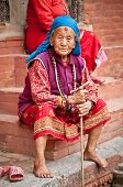 KATHMANDU, NEPAL - MAY 18 - Old woman sit in the retirement home founded by Mother Teresa in Rajraje