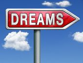 dreams realize and make your dream come true be successful and accomplish your goals red road sign a
