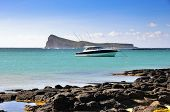 stock photo of outboard  - Luxury boat moored near coast at the Mauritius island - JPG