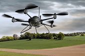 stock photo of drone  - Illustration of a surveillance drone searching the countryside - JPG