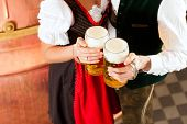 stock photo of stein  - Man and woman with beer glass in brewery - JPG