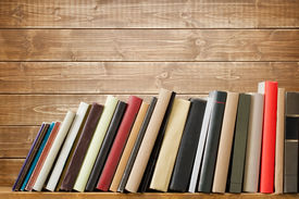 picture of spine  - Old books on a wooden shelf - JPG