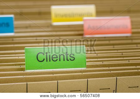 A hanging file folder labeled with Clients
