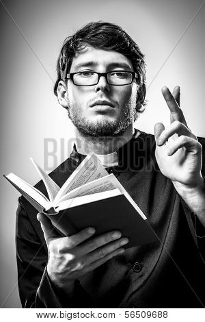 Priest Is Lecturing Holy Scripture To Believers