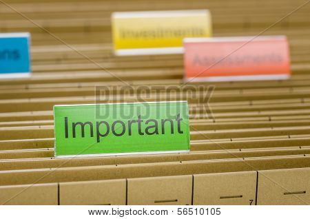 A hanging file folder labeled with Important