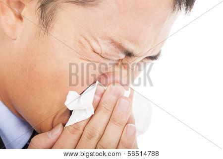 Young Man Is Sneezing With Toilet Paper