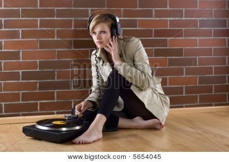 Women In Trenchcoat Listens Music