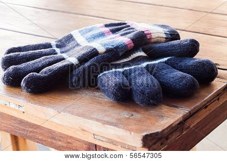 Close Up Winter Gloves On Wood Table