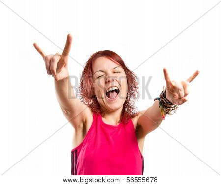 Young Girl Doing Horn Gesture Over White Background