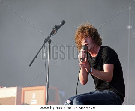 Matt Bowman of The Pigeon Detectives indie / rock band playing on stage at Hop Farm Festival, Kent,