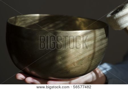 Large Tibetan Singing Bowl And Baton Being Held.