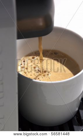 Espresso Coffee Pouring Into A Cup