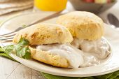 stock photo of buttermilk  - Homemade Buttermilk Biscuits and Gravy for Breakfast - JPG