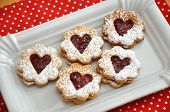 stock photo of augen  - Traditional home made Linzer Cookies filled with jam - JPG