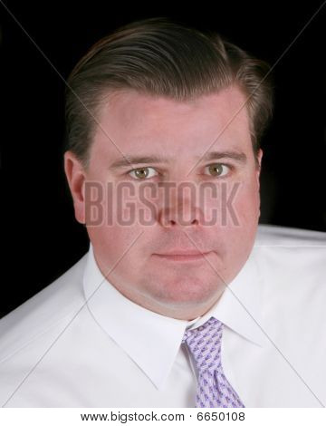 Head Shot Of A Businessman Isolated On Black