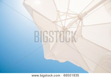 White Parasol Closeup On Blue Sky Background
