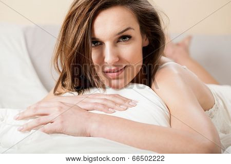 Beautiful Woman Smiling Seductively In Bed