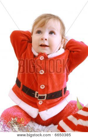 Little Happy Girl In Red Santa's Clothes