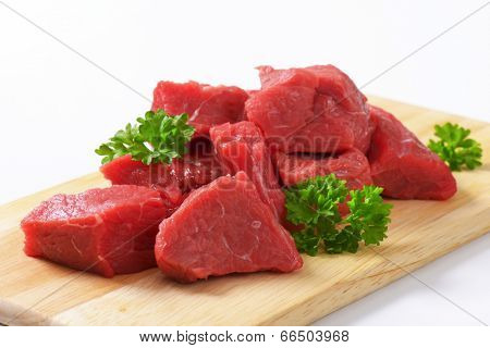 diced raw beef meat on the cutting board