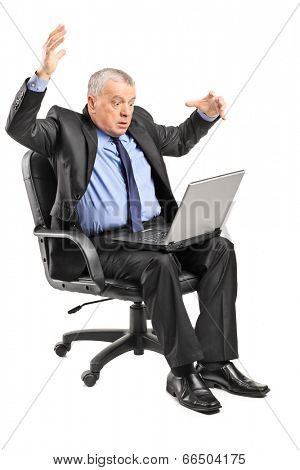 Shocked businessman having problems with his laptop isolated on white background