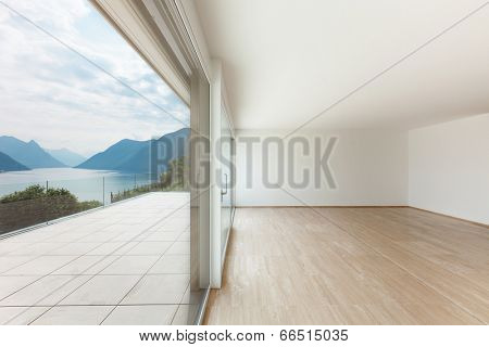 Interior, modern penthouse, empty living room with large window