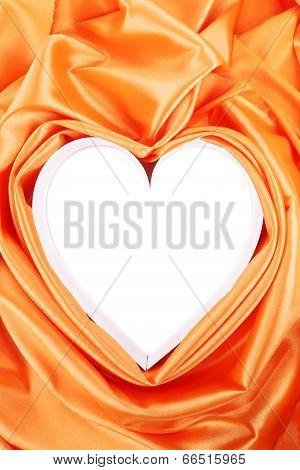 Paper heart in orange satin.