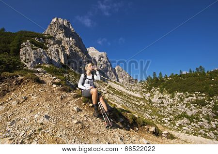 Hiker Resting And Drinking Water