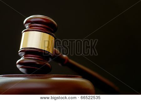 Gavel Resting On A Wooden Plinth
