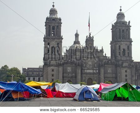 Protestors in a tents in front of the main cathedral on Zocalo in Mexico City