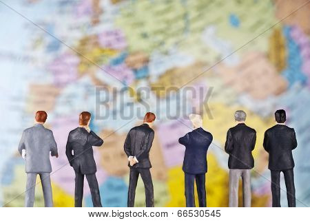 Businessmen In Front Of A Globe