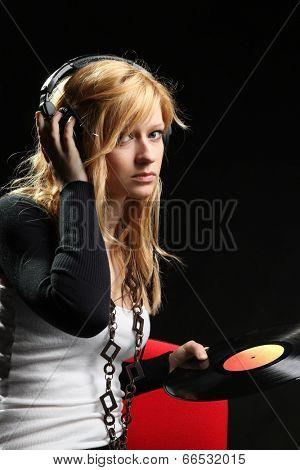 Blonde girl listening music with headphones