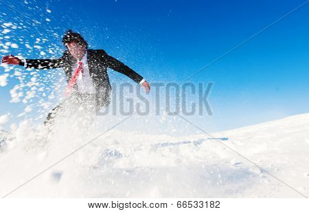 Businessman snow boarding.