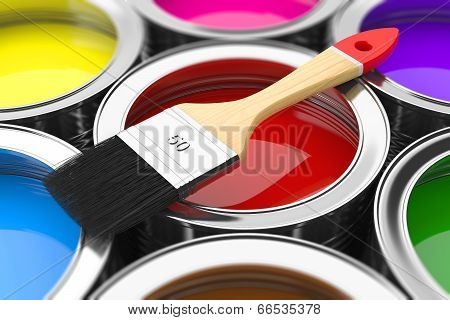 Paintbrush On Cans With Color Prints