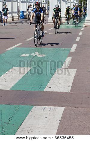Cyclists Ride The Bike Path Along The Promenade