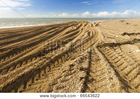 Caterpillar Tracks From Digger On Stony Beach