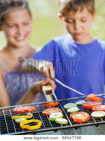 Kids having a barbecue party
