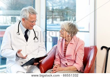 Male Doctor In Consultation With A Senior Patient