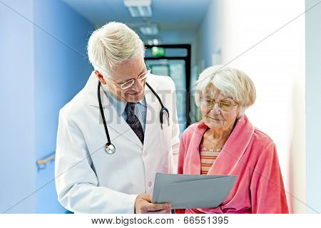 Doctor Shows Female Elderly Patient Results