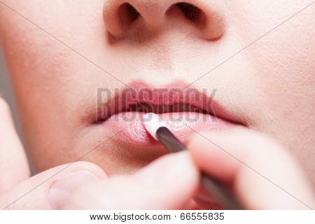 Makeup. Girl Applying Lipgloss Lipstick On Lips. Part Of Face.