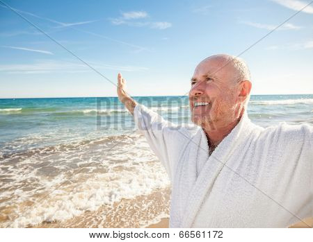 carefree man with outstretched arms happy beach