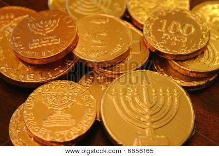 Hanukkah coins on wood table