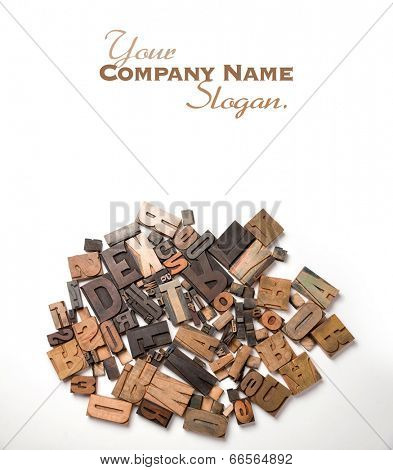 Wooden typescript letters against a white background