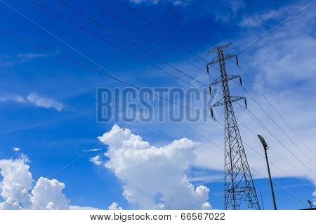 High Voltage Pole Against Blue Sky