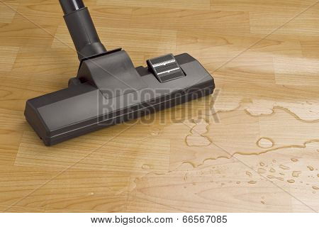 vacuum cleaner brush cleaning water on the floor