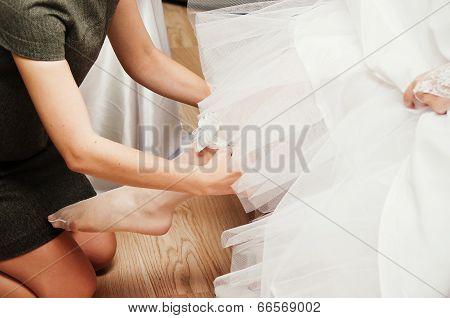 Bride Putting Garter On Leg