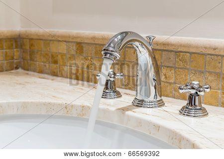 Modern Water Tap In The Bathroom. Flowing Water.