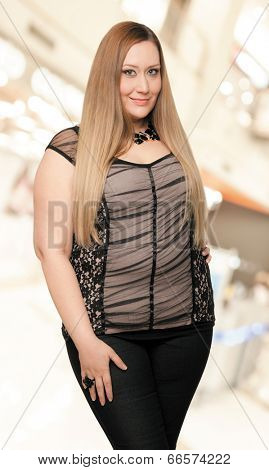 Young beautiful overweight woman with long blond hair. Work path.